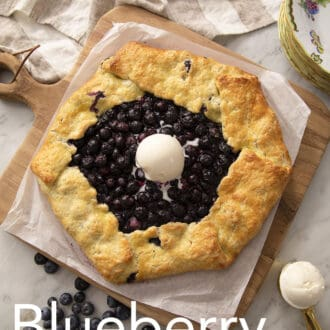 A blueberry galette topped with ice cream.