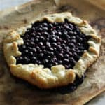 a blueberry galette on parchment paper