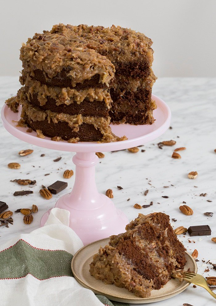 a phopto of a german chocolate cake with a piece cut out.