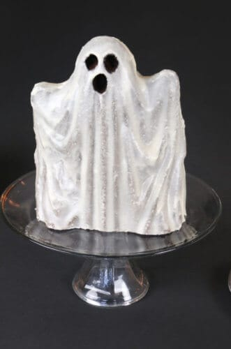 A photo of a ghost made out of vanilla cake.