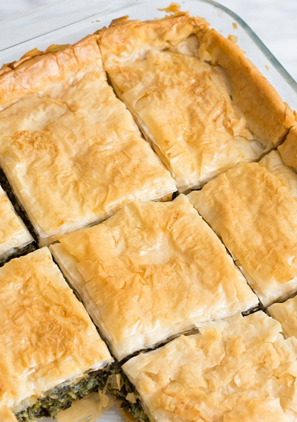 A photo showing the golden brown filo top of baked spanakopita