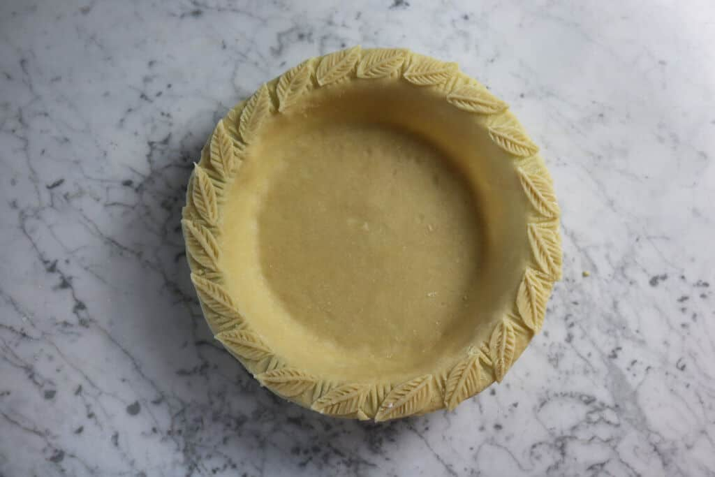 A photo of pie crust ready to go into the oven.