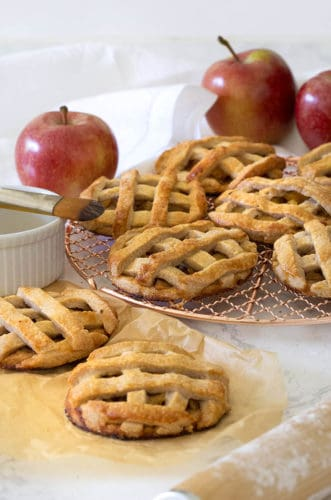 mini apple pies on a copper cooking rack