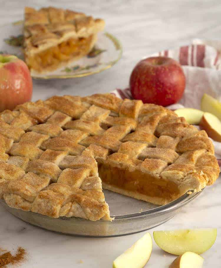 apple pie with a piece cut out on a small plate