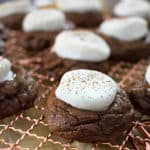 hot chocolate cookies on a copper cooling rack