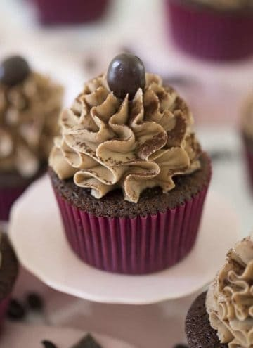 Lots of mocha buttercream and a chocolate-covered espresso bean top a chocolate cupcake
