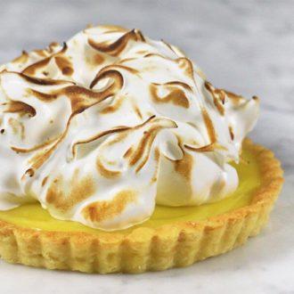 A closeup photo of a lemon curd tart