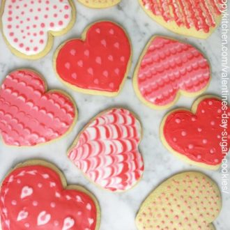 a photo of heart cookies on a marble table