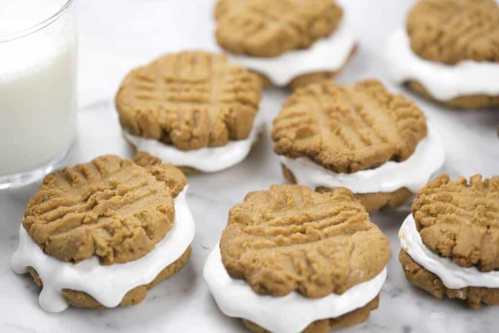 A photo of delicious Peanut Butter Marshmallow Sandwich Cookies.