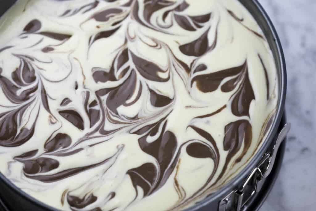 A chocolate marble cheesecake ready to go into the oven.