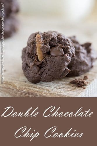 A pinterest image for double chocolate chip cookies featuring two cookies