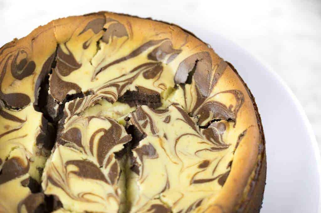 A photo of a Chocolate Marble Cheesecake.