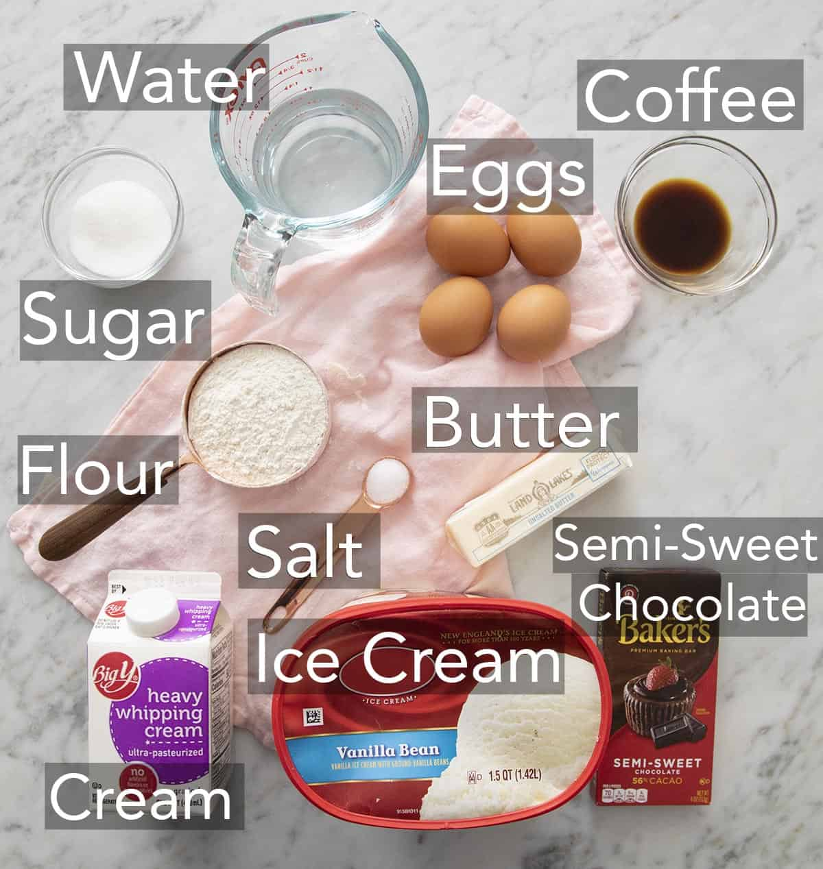 Ingredients for making profiteroles on a counter.