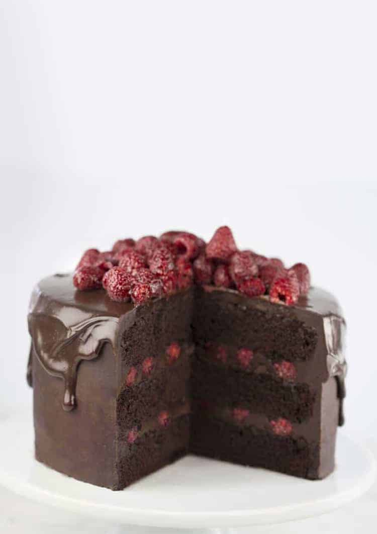 a Chocolate raspberry cake with a few pieces removed