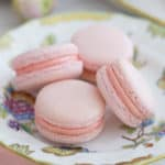 soft pink macarons on a hand painted porcelain plate