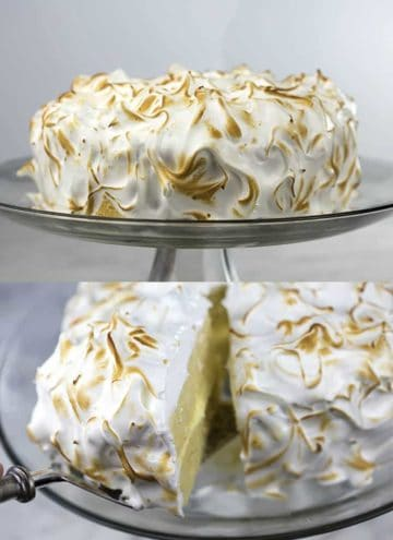 A lemon cake covered in toasted meringue on a glass cake stand