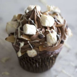 A rocky road cupcake on a white marble table