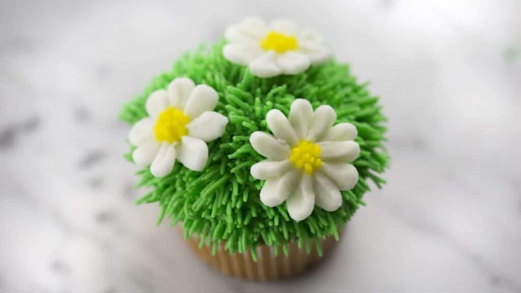 A photo of an Easter daisy cupcake