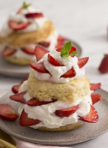 two strawberry short cakes topped with mint