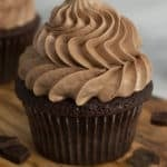 A chocolate cupcake topped with a swirl of chocolate buttercream