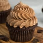 a chocolate cupcake crowned with a giant dollop of buttercream