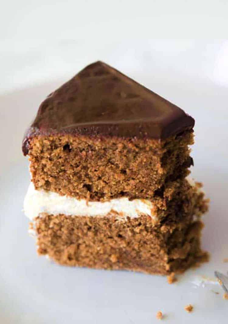 A piece of chocolate marzipan cake with chocolate ganache
