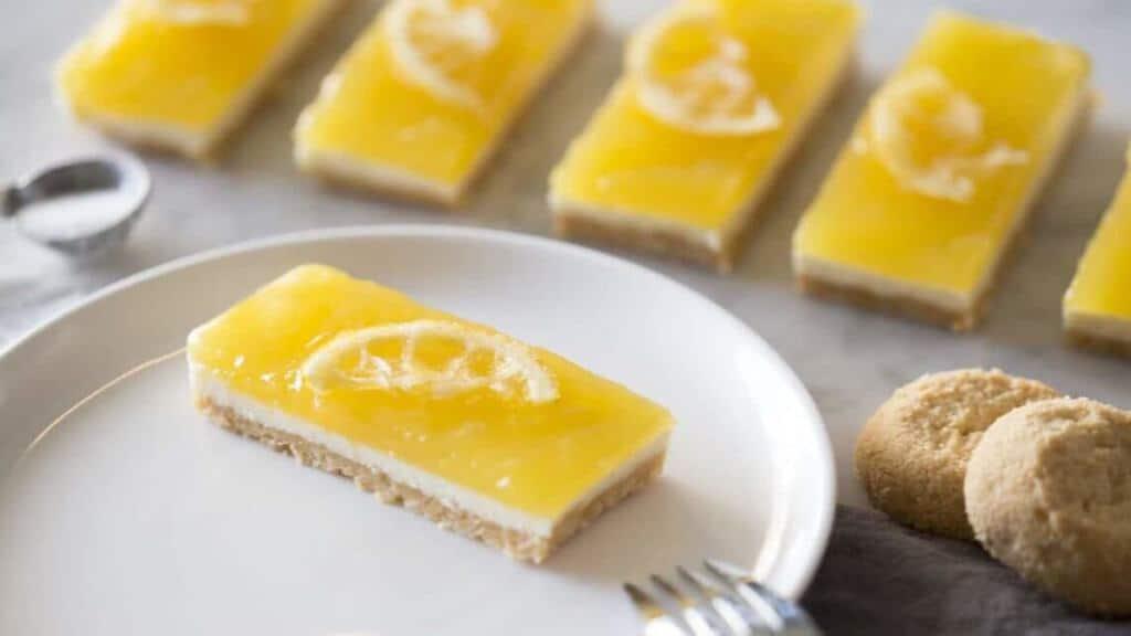 A photo of a No Bake Lemon Cheesecake Bar on a plate.