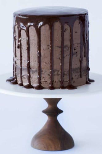 A photo of a Chocolate Chocolate Cake on a cake stand.