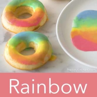 rainbow donuts on a white marble counter