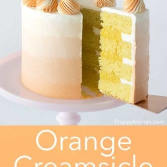three layer orange creamsicle cake with orange to white ombre decoration