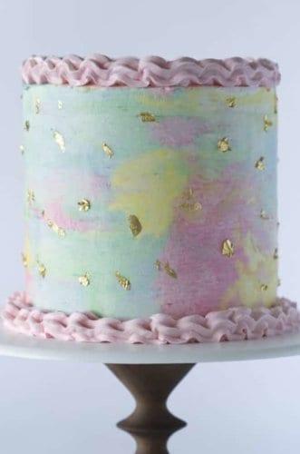A photo of a beautiful Unicorn Cake on a cake stand.