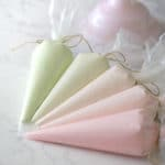 Bags of Italian Meringue Buttercream in a green to pink gradient