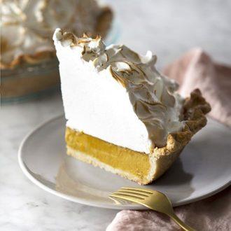 A slice of pumpkin meringue pie on a plate.