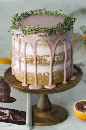 A photo of a Blood Orange Thyme Cake on a cake stand.