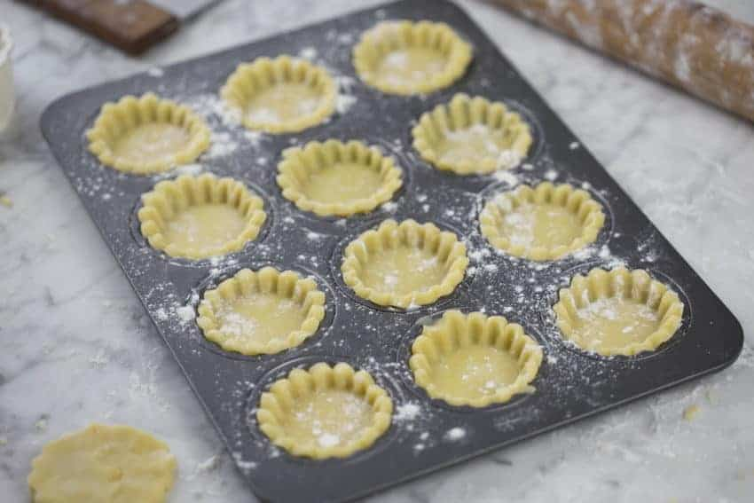 A photo of Tart shells ready to be baked.