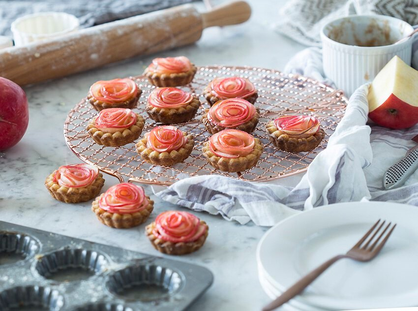 A photo of Rose Apple Tarts on a marble table.