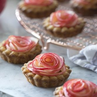 An apple is peeled and rolled up to look like a single rose and baked into a rose apple tart.