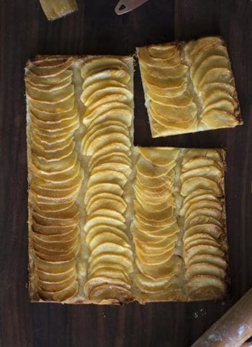 An apple tart with slices arranged in rows.