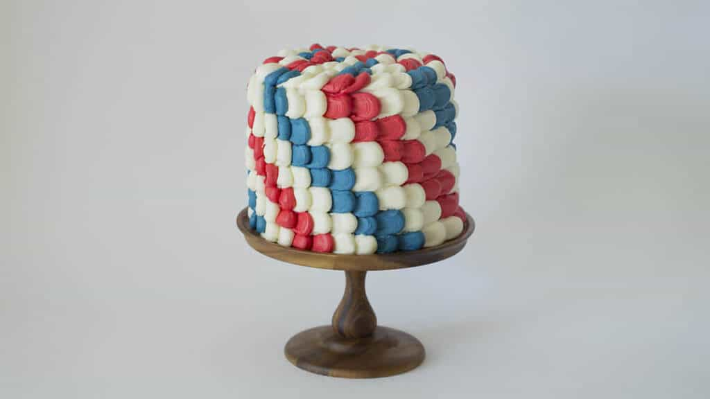 A photo of a red, white and blue cake.