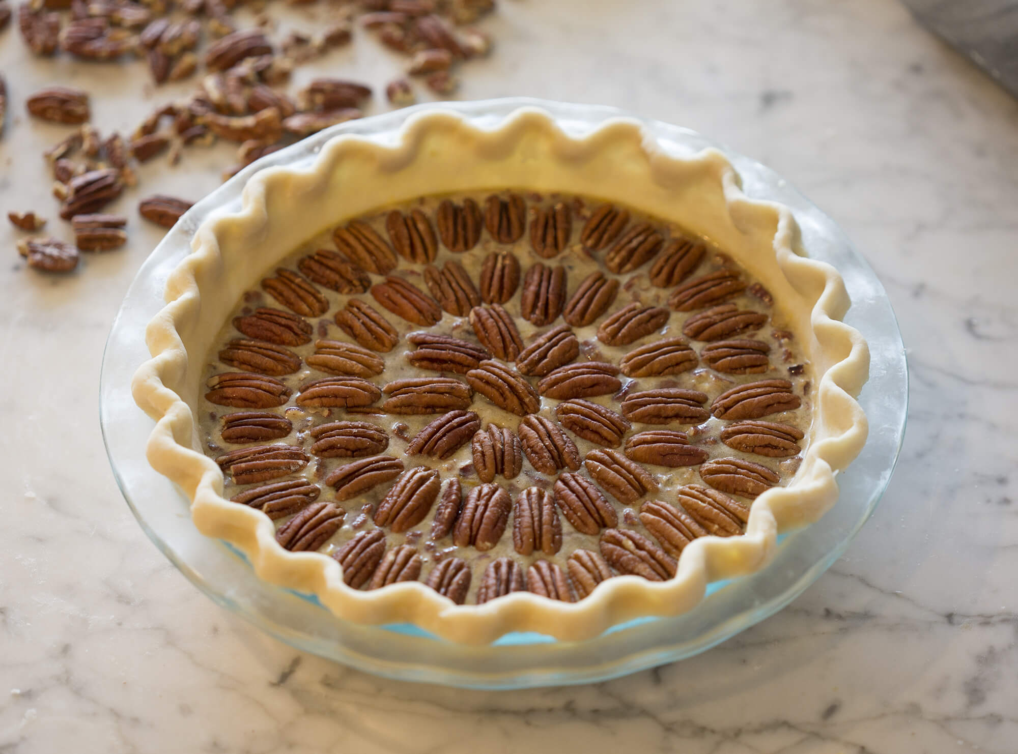 photo of a pecan pie ready to go in the oven