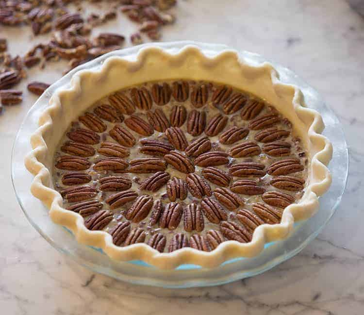 photo of a pecan pie almost ready to go in the oven