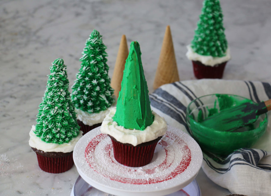 Christmas tree cupcakes with final coat of icing about to be applied