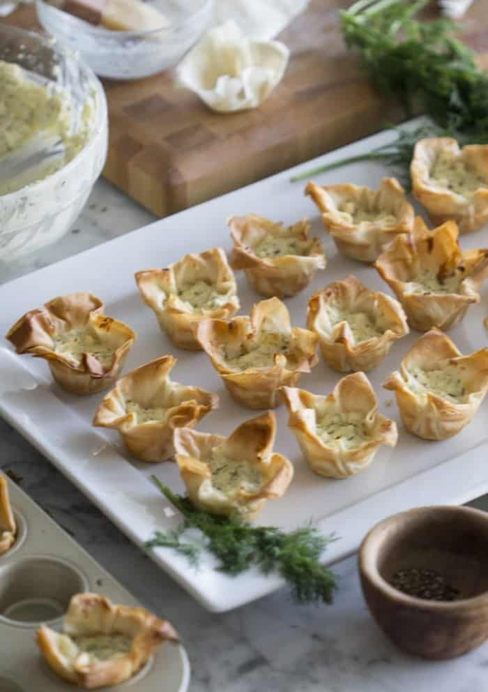 a photo of Cheesy Filo Cups on a serving plate.