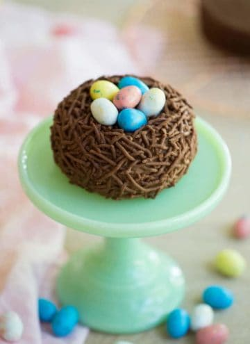 A photo of a Bird's Nest Easter Cake on a mini cake stand.