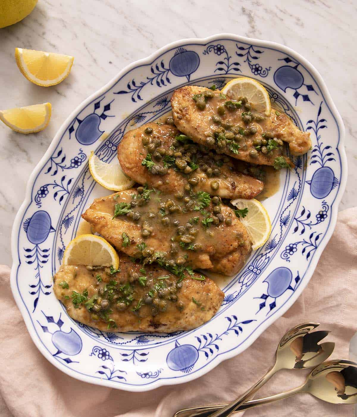 Chicken Piccata on a blue serving plate