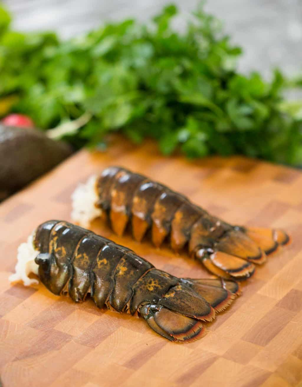 A photo of two lobster tails.