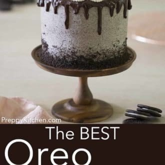 three layer oreo cake with chocolate ganache drip on a cake stand