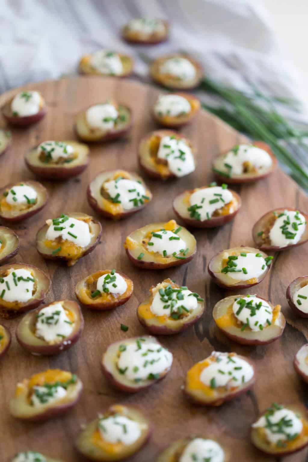A photo of potato bites on a serving board.