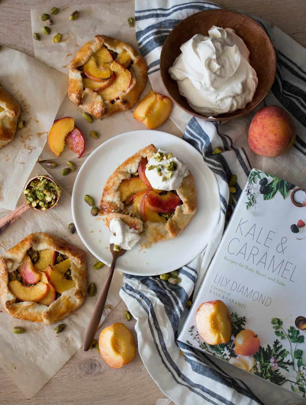 A Peach & Pistachio Galette on a plate.