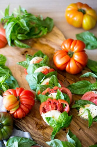 A photo of a delicious caprese salad on a serving board.